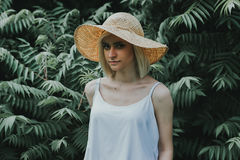 Front view of the girl in a white shirt in the background is a wall of hedges Royalty Free Stock Photos