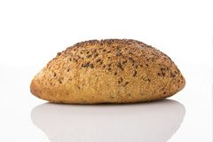 Front View of Golden Brown Sourdough Bread  on White Background Shot in Studio. Sourdough bread is made by the fermentation of dough using naturally occurring Stock Photo