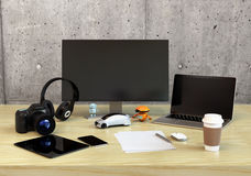 Front view of graphic designer desktop. With DSLR camera,laptop PC and bezel-less monitor. 3D rendering image Stock Photos