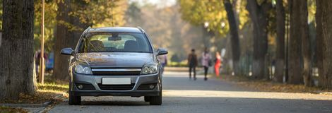 Front view of gray shiny empty car parked in quiet area on aspha royalty free stock photography