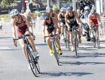 Front view of a group of triathlete cyclists Stock Image
