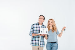 Front view of happy couple holding house model and keys Stock Images