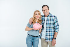 Front view of happy couple holding piggy bank Royalty Free Stock Images