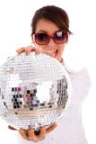 Front view of happy woman holding disco ball Royalty Free Stock Photos