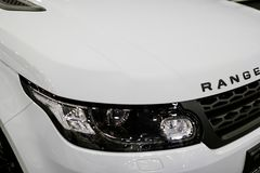 Front view headlight of a white Land Rover Range Rover Sport 2017. Car exterior details. Stock Photo
