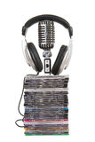 Front view of headphones , vintage microphone, dvd Royalty Free Stock Photo