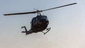 Front view of helicopter in flight. Fly on blue sky Stock Photography