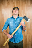 Front view of hipster standing with axe Stock Images