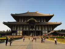 Front view on the historic Todai-ji temple and people, Nara Japan. Front view on the beautiful historic Todai-ji temple and people walking from and toward it Stock Photos