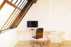 Front view of home office in attic, toned Royalty Free Stock Photography