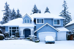 Front view of home during winter snowfall royalty free stock images