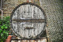 Front view of a huge barrel in a rustic corner Stock Photo