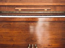 Front of a wooden piano. stock photos