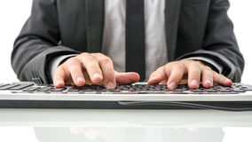 Front view of insurance agent typing on computer. On his white office desk Royalty Free Stock Image