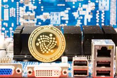 Front view of Iota cryptocurrency physical coin royalty free stock image