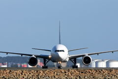 Front view of jet aircraft on runway Stock Photography