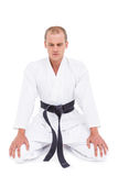 Front view of karate fighter meditating Royalty Free Stock Photos