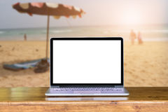 Front view of laptop on wooden table in Office and business in m. Eeting room blurred background. Laptop with blank screen and can be add your texts or others on Royalty Free Stock Photos