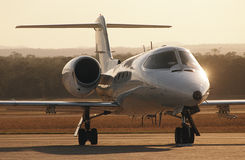 Front view Lear jet on tarmac royalty free stock image