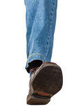 Front view of left leg in jeans and brown shoe Royalty Free Stock Photos
