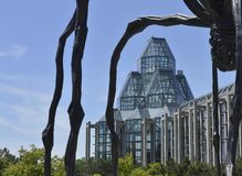 Front view through the legs of a spider statue of Canada`s National Art Museum stock images