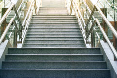 Front view of long stairs going up with bright sunlight. Stock Photo