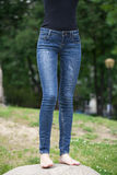 Front view of a long women legs posing with jeans Stock Photos