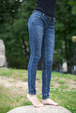 Front view of a long women legs posing with jeans Royalty Free Stock Photos