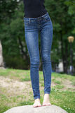 Front view of a long women legs posing with jeans Stock Photography