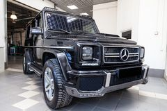 Front view of luxury very expensive new black Mercedes-Benz G-class 350d car with brabus tuning stands in the washing box waiting stock image