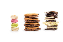 Front view of macaroons, cookies and chocolate bars Royalty Free Stock Photos