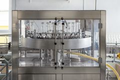 A front view of a machine for washing glass bottles. Production and bottling of alcoholic beverages Royalty Free Stock Photography