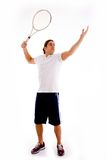 Front view of male carrying racket Royalty Free Stock Photography