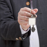Front view of male hand with blank door keychain. Close up royalty free stock photos