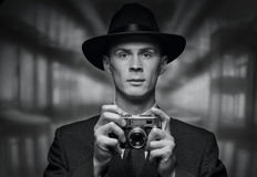 Front view of man holding vintage camera Stock Photos