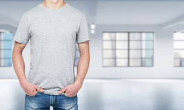 Front view of a man in a light grey t-shirt and denims. Royalty Free Stock Photo