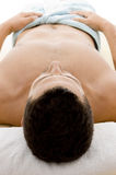 Front view of man lying down for spa treatment Royalty Free Stock Images