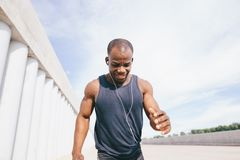Front view Healthy young athletic man running royalty free stock photos