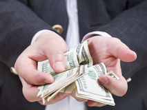 Front view of many dollar banknotes in male hands Stock Image