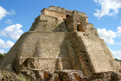 Front view mayan pyramid. Uxmal main pyramid over blue sky with clouds royalty free stock photos