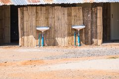 Front view of men's washroom in campsite.Thailand. Hut wooden travel traditional tourism nature construction background architecture area bathroom building stock photography