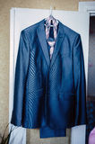Front view of a Mens wool pinstripe suit jacket. With tie and white shirt stock image
