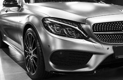 Front view of a Mercedes Benz C 43 AMG 4Matic V8 Bi-turbo 2018. Car exterior details. Black and white. Sankt-Petersburg, Russia, January 12, 2018: Front view of stock images