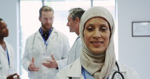Front view of Middle-east female doctor standing with arms crossed in hospital stock footage