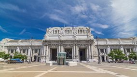 Front view of Milan antique central railway station timelapse hyperlapse. Blue cloudy sky at summer day. The station was inaugurated in 1931 stock video