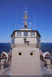Front view of military ship bridge control room against clear bl Royalty Free Stock Photo