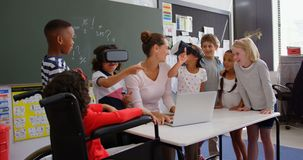 Front view of Mixed-race schoolkids using virtual reality headset with teacher and classmates i 4k. Front view of Mixed-race schoolkids using virtual reality stock video