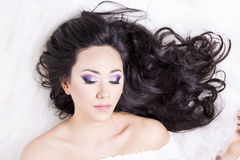 Front view of model portrait with black hair over white Stock Photography