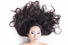 Front view of model portrait with black hair over white Stock Images