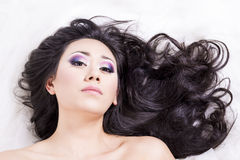 Front view of model portrait with black hair over white Royalty Free Stock Photography